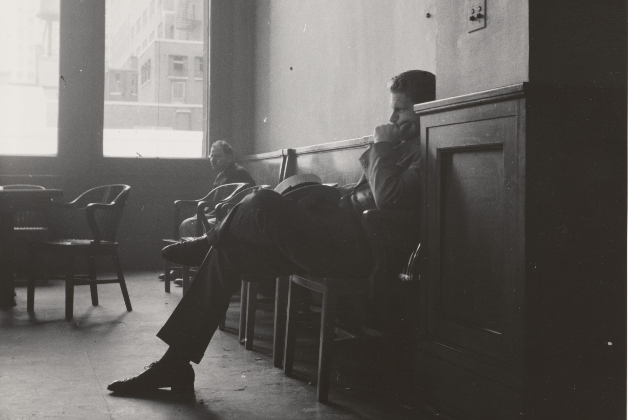 Dangling Ma's review has inspired this featured image of a man in a bar in New York, in 1939. Photo taken from the New York Public Library collection.