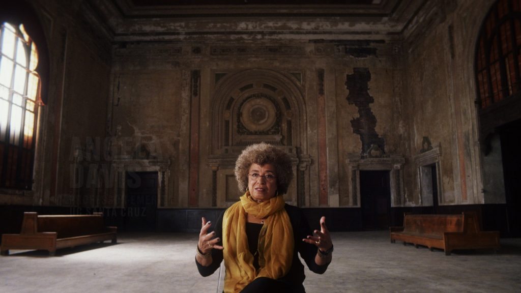 Photo of Angela Davis in an abandoned railway station