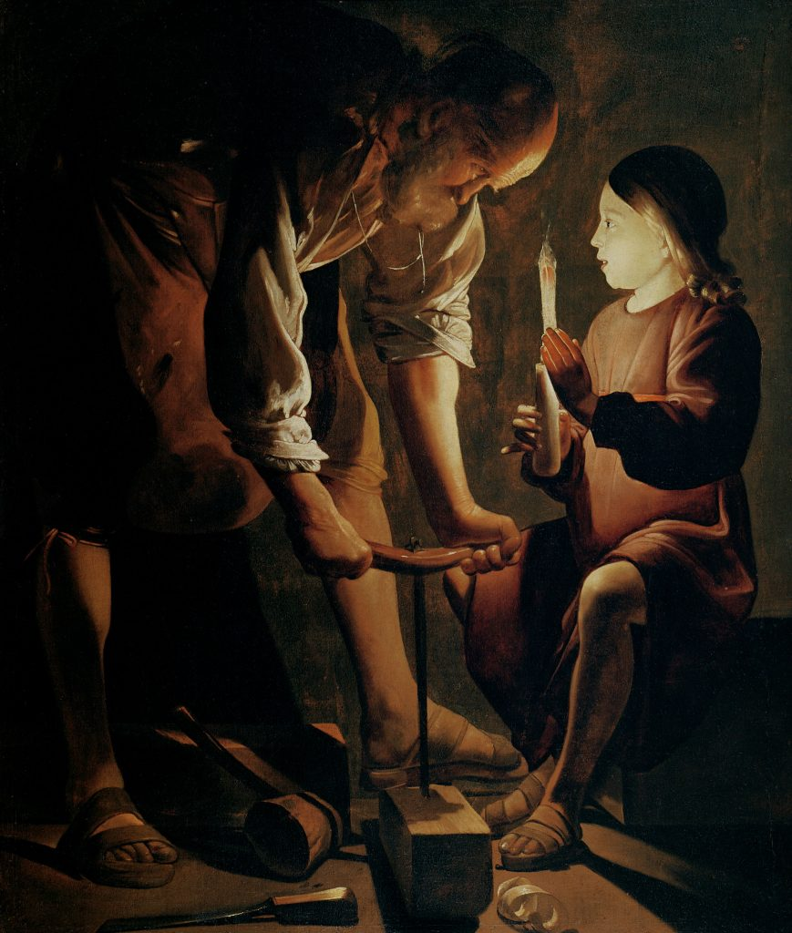 Painting of an old man (Saint Joseph) and child holding a candle