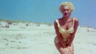 Tish on the beach in a sunny day, from the movie I'm gonna make you love me