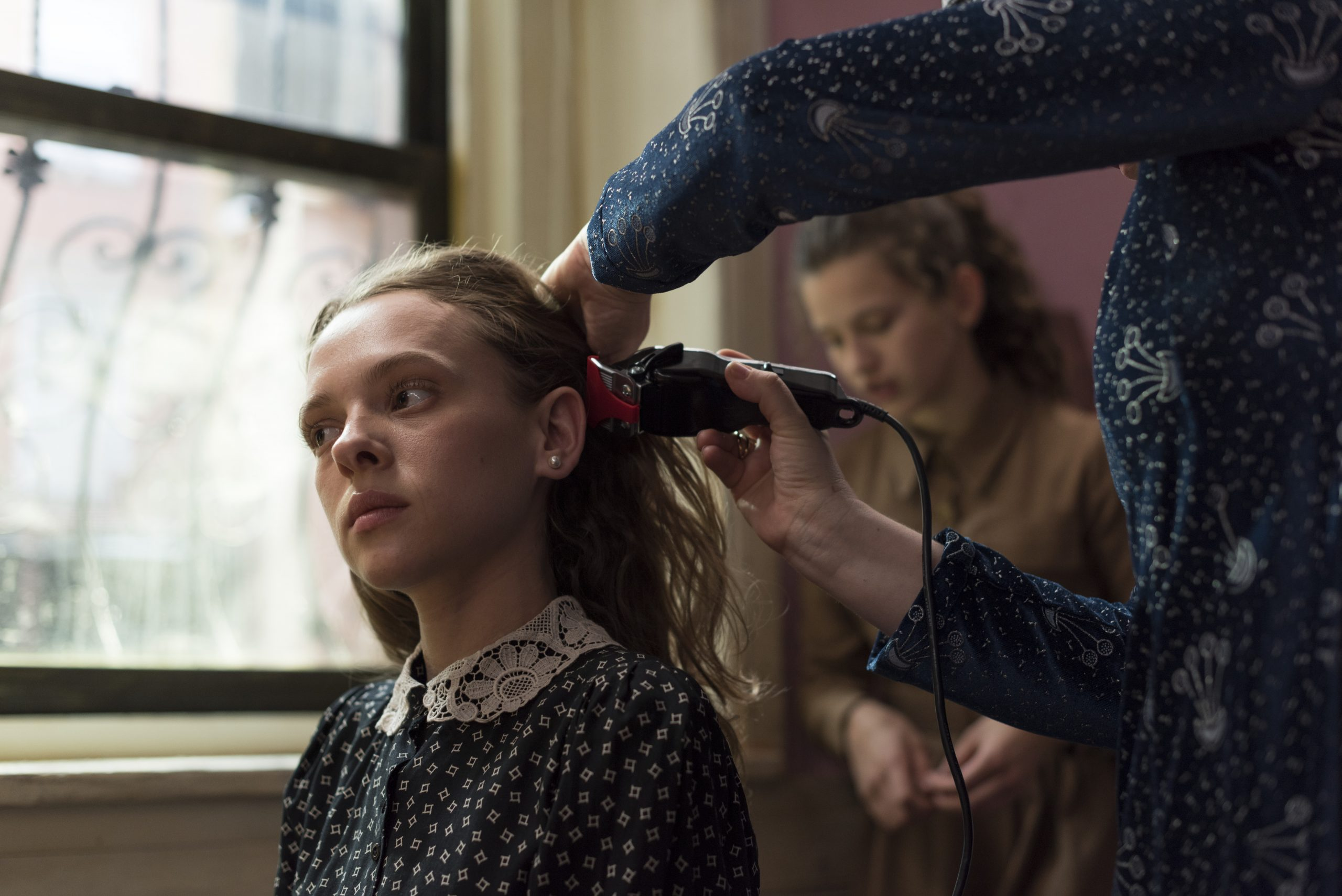Esty is getting shaved by a woman after her marriage
