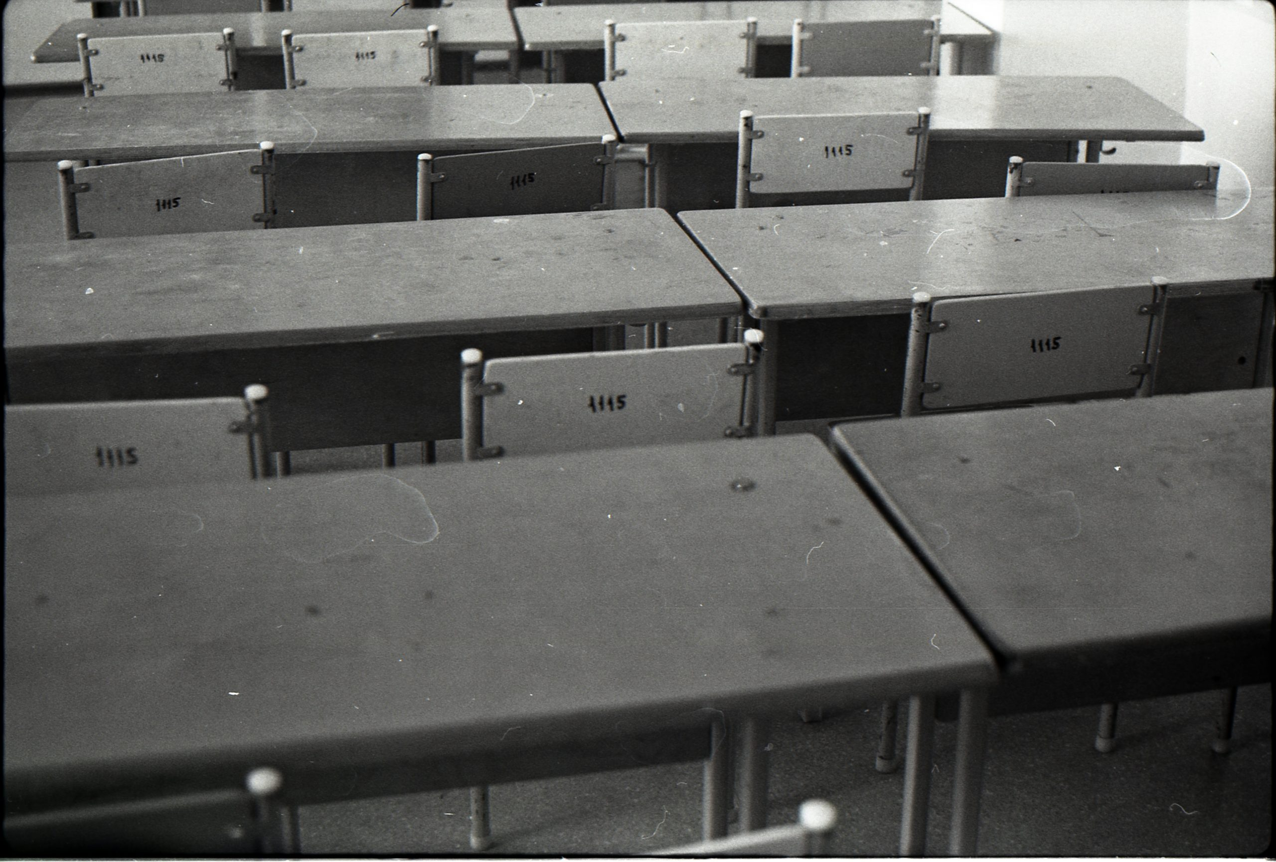 A row of desks in a classroom.