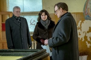 Chernobyl - A woman and two men are discussing inside a room on a plan to follow and save millions of lives
