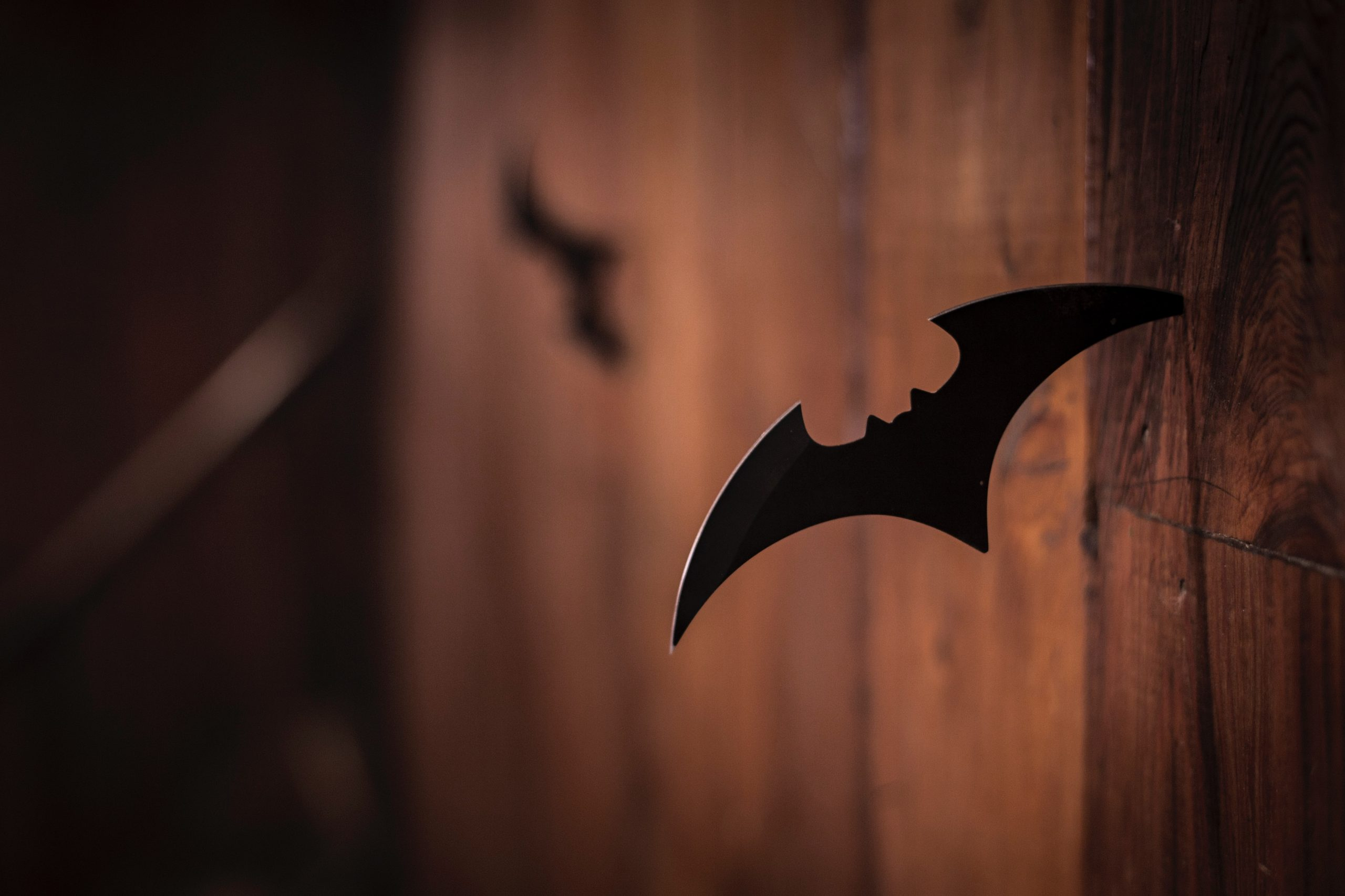 "A shuriken depicting the symbol of the superhero Batman, also known as ""The Dark Knight"""