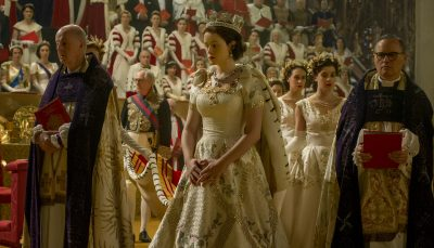 A young Elizabeth (Claire Foy) is surrounded by church representatives on the day of her coronation